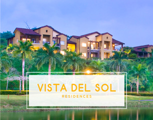 Building behind lake in Vista del Sol Residences